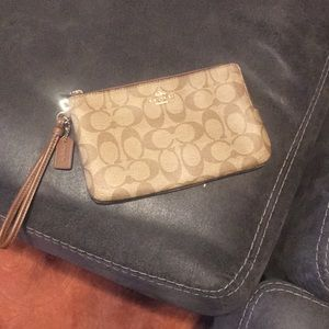 Like new condition Coach wristlet